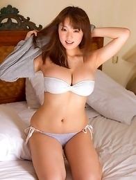 Ai Shinozaki with huge knockers plays with pillows in bed